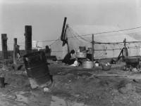 Dorothea Lange - Migrant Camp Washing, 1938