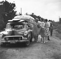 Ron Church, Sunset Beach Tourists, Women Looking At Surfboards On Car, Hawaii, circa 1963