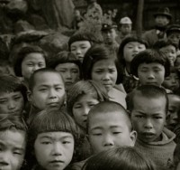"Horace Bristol, Faces of Japanes Children Watching ""Paper Theater"", Japan, 1946"