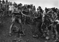 Sebastiao Salgado - Military Police Patrolling the Gold Mine at Serra Pelada, State of Para, Brazil, 1986