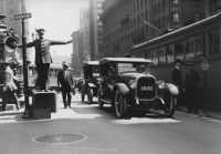 Anonymous – A Policeman is Directing Traffic on Kearny Street