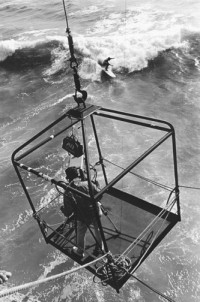 Huntington Beach and TV Cameraman in cage, circa 1963