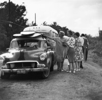 Sunset Beach Tourists, Women Looking at Surfboards on Car, 1963