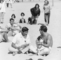 Teenage Boys Playing Guitar at Huntington Beach, circa 1963