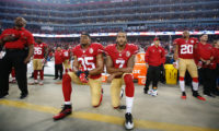 Michael Zagaris, Colin Kapernick Taking a Knee for Justice with Eric Reed, 2016