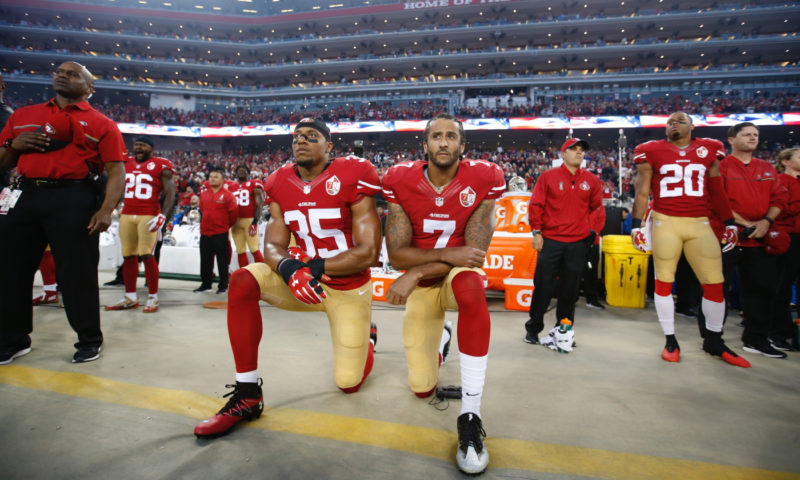 Michael Zagaris,Colin Kapernick Taking a Knee for Justice with Eric Reed, 2016
