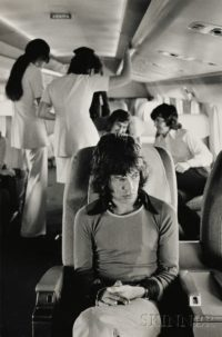 Mick Jagger on Airplane, 197