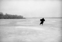Joel Bernstein, Joni Mitchel Skating on Lake Mendota with Treeline, Madison, WI, March 1976