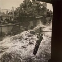 Transferring Rescued Pilot from Destroyer to Carrier, 1942