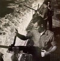 Firing Machine Guns on Deck of Submarine, 1944
