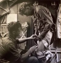 Rescue at Rabaul: Bandaging Wounded Bomber, 1944